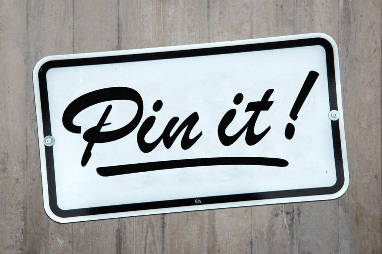 """""""Pin it"""" written on sticker"""
