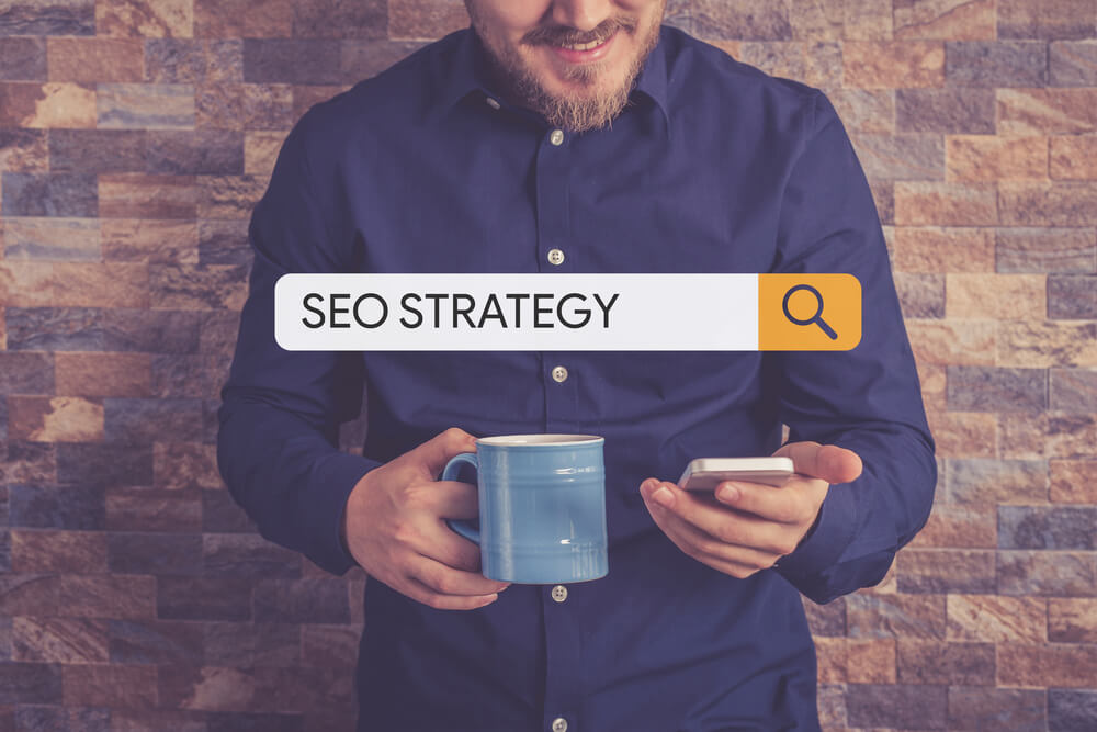 "Man on phone searching ""SEO Strategy"""
