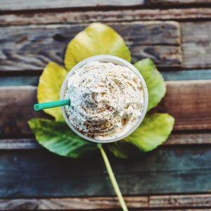 starbucks coffee on a leaf