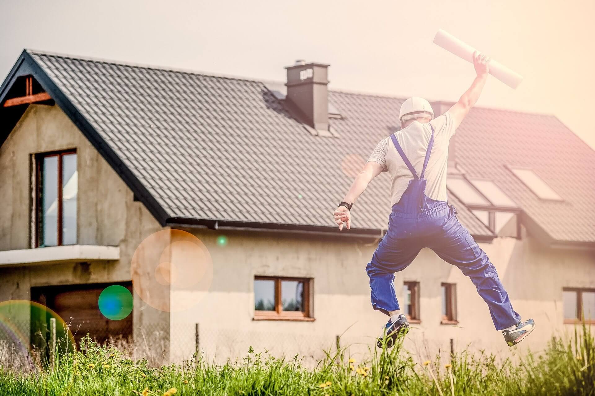 construction worker jumping for joy because he optimized his Houzz profile with our tips