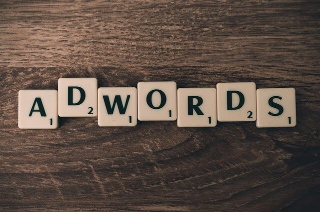 Adwords spelled out with Scrabble tiles