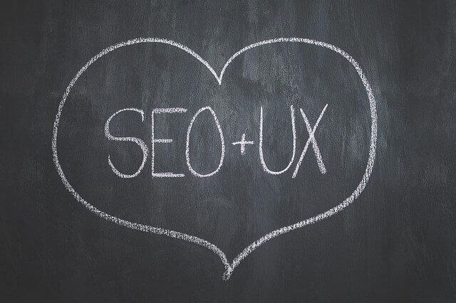 seo and ux written on chalkboard inside a heart