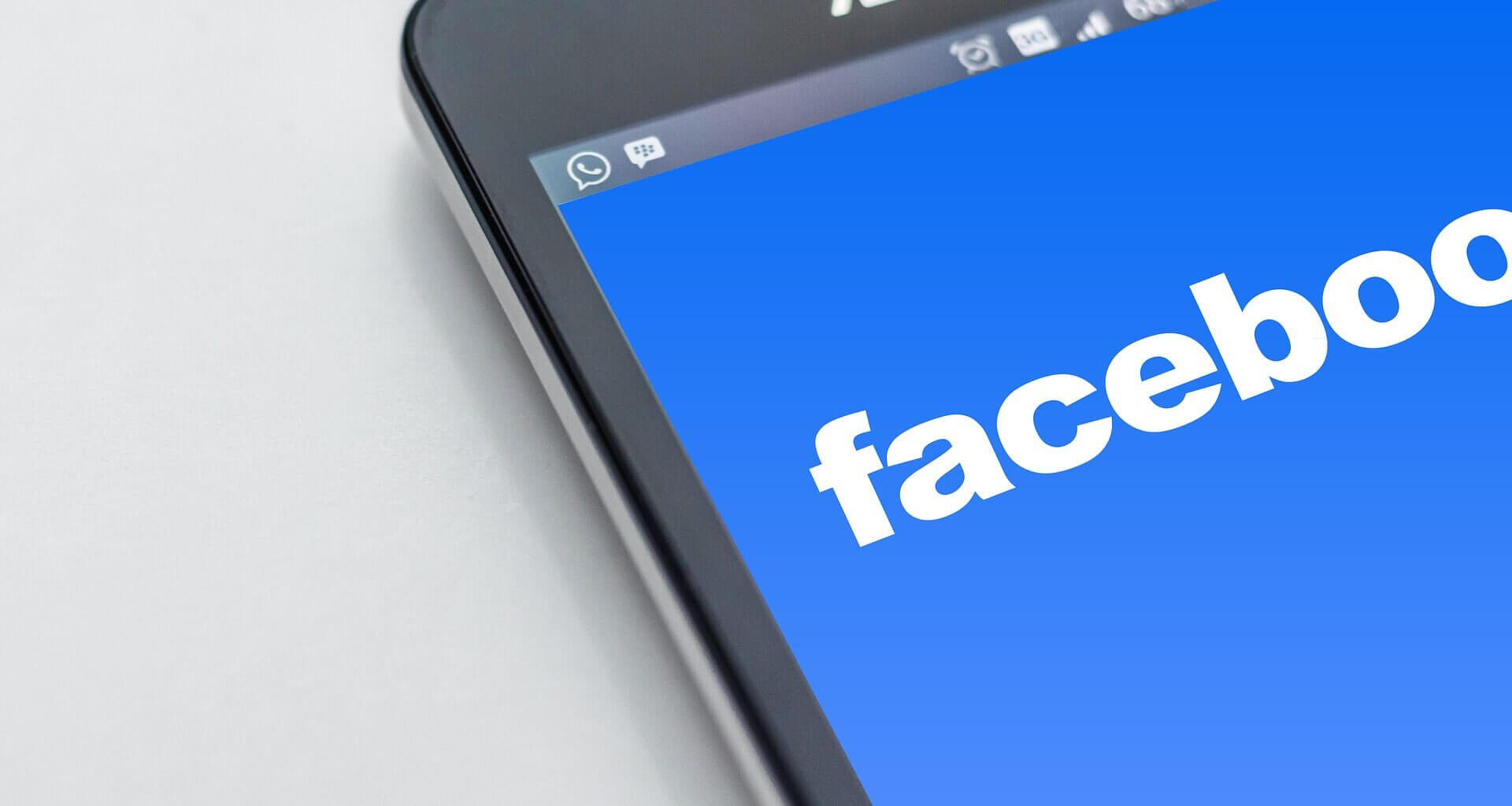 Facebook logo on mobile device