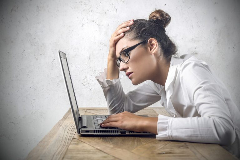 woman bored on computer