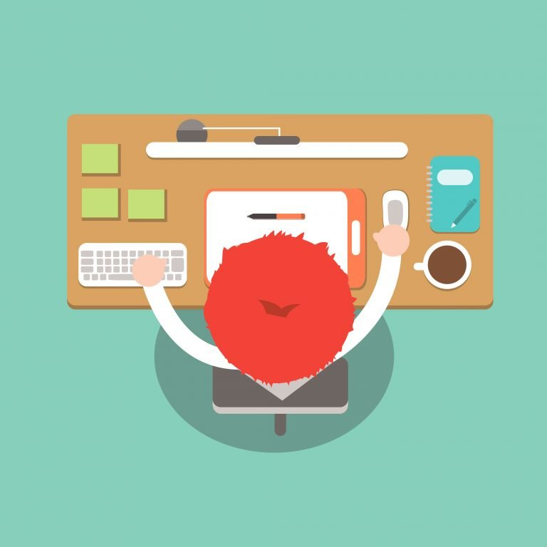 man at desk typing
