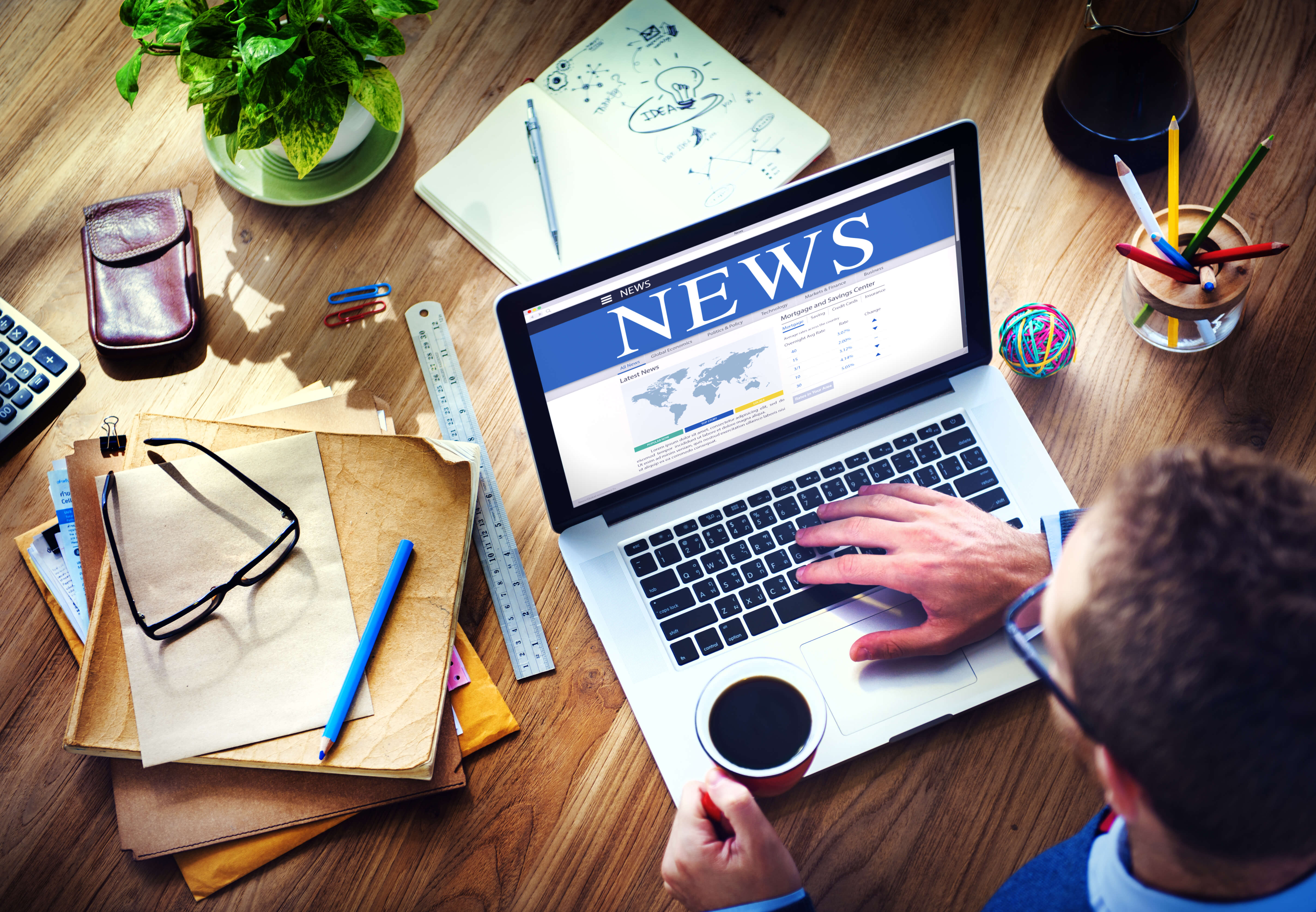 News publication on laptop screen