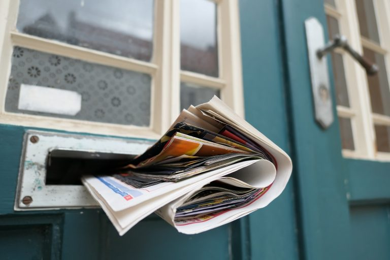 Newspaper in mail slot
