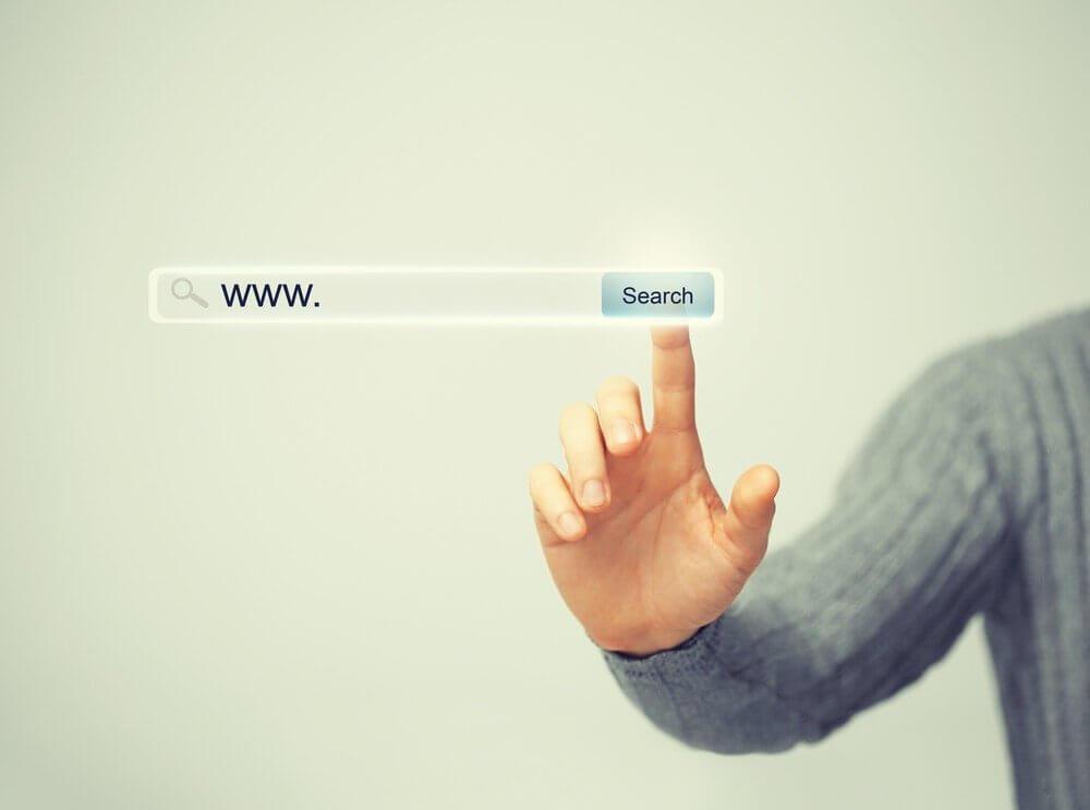 "man pressing ""search"" button"