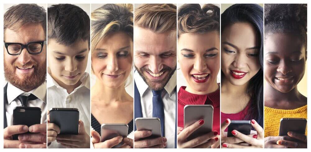A photograph of people from all walks of life looking at their phones and smiling.