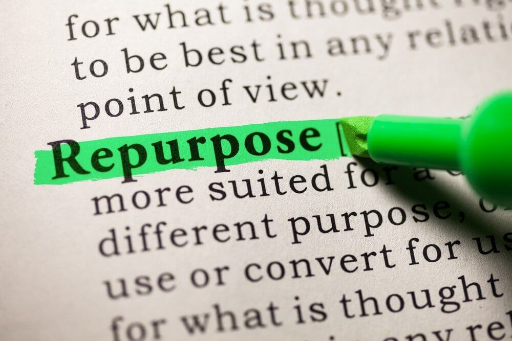 "A photograph of the word ""repurpose"" being highlighted in green."