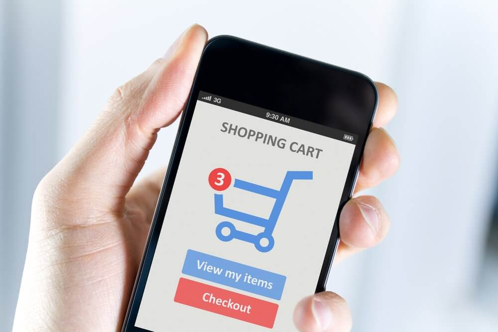 mobile phone with shopping cart icon on it