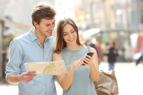 tourists using phone and map