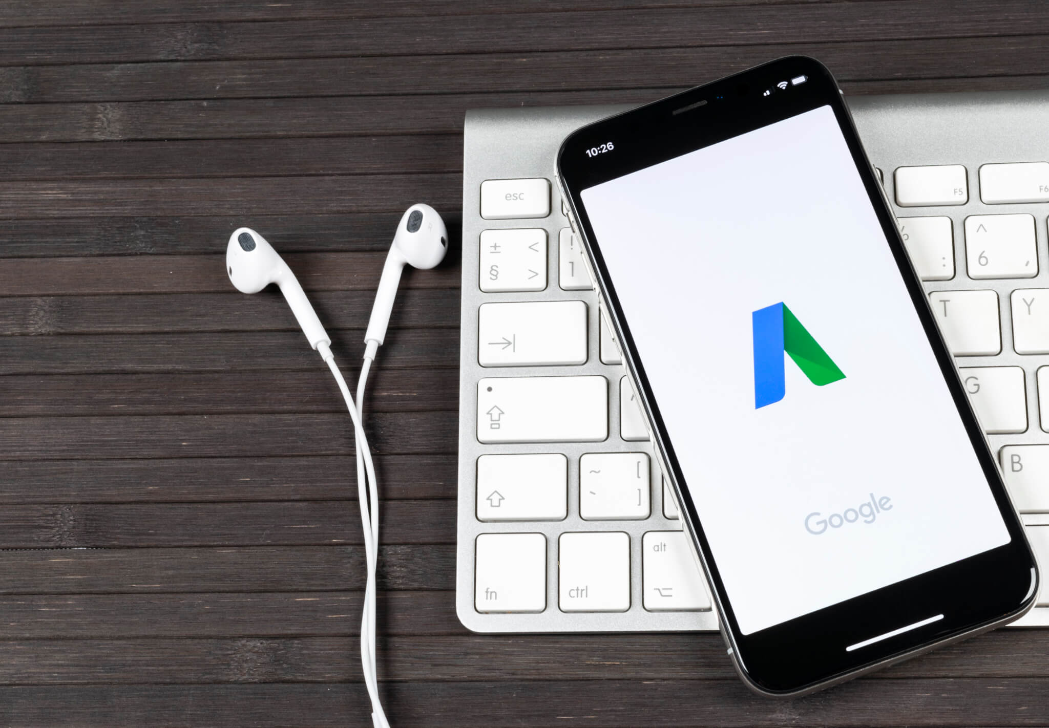 phone with google ads and keyboard