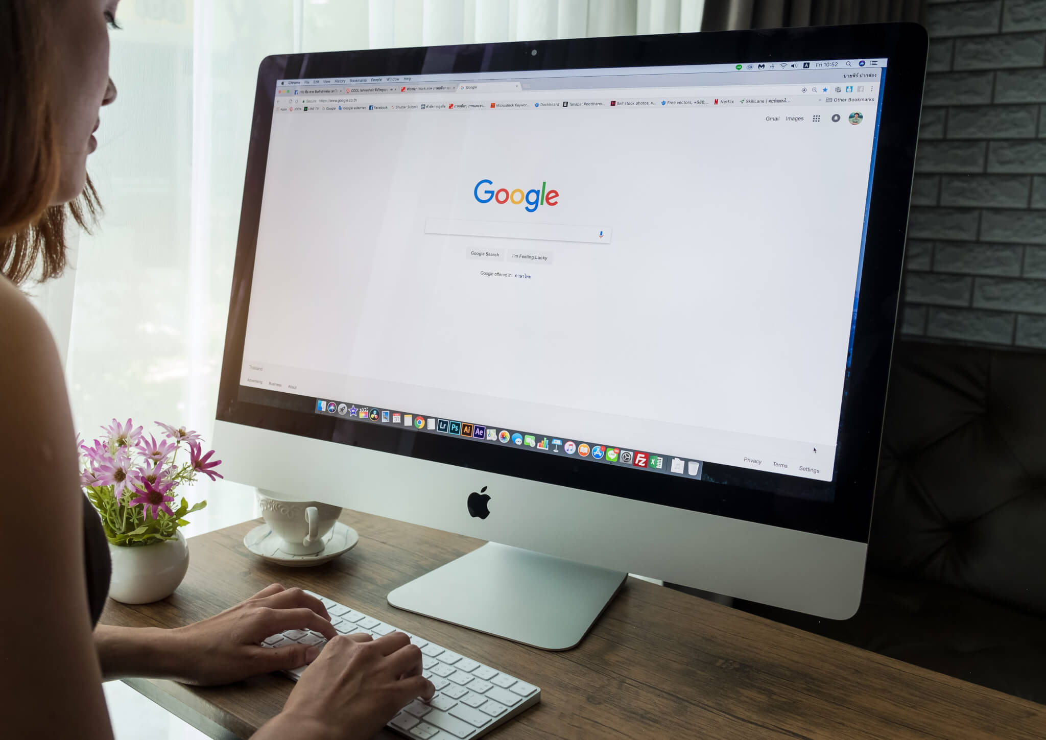 girl searching through google using a mac