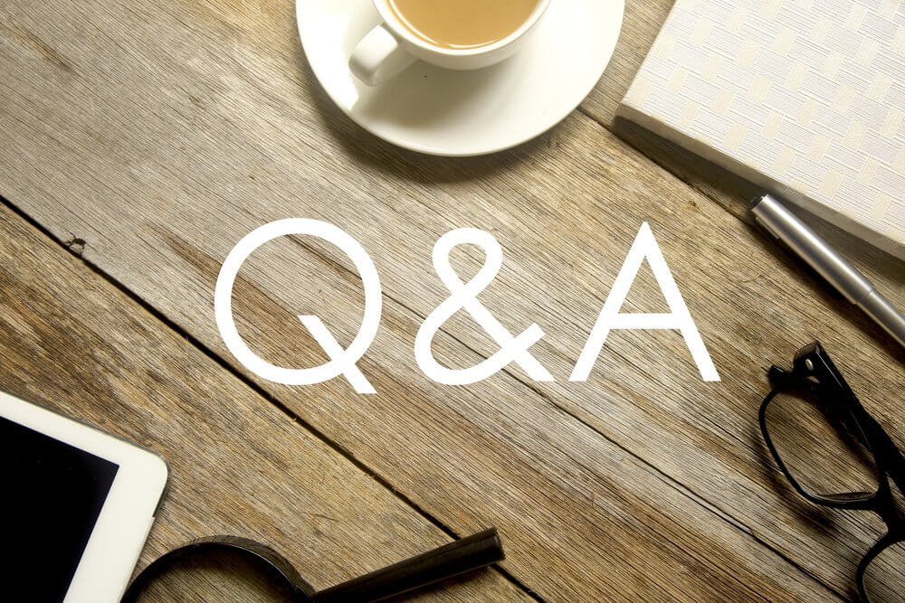 stock image of Q&A in white on a wood table