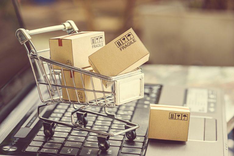 Online Shopping Cart on Laptop keyboard