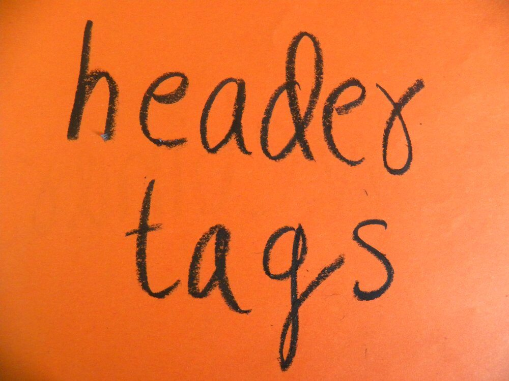"""Header Tags"" written on a piece of paper"