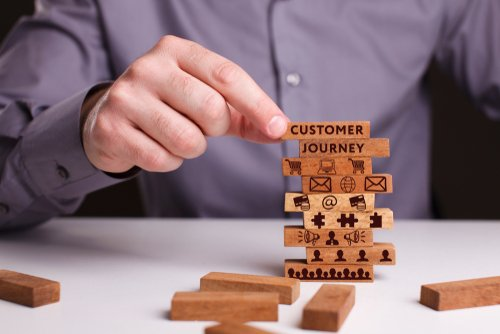 male using building blocks as an analogy for the customer journey