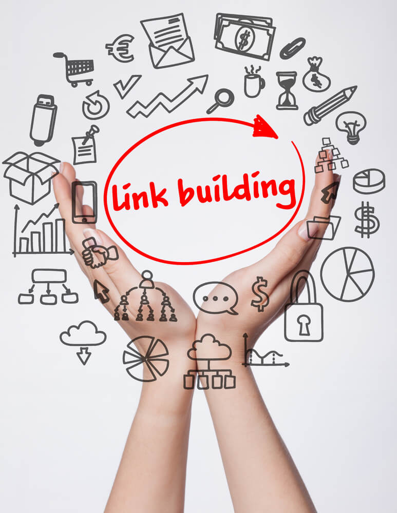 Hands holding a variety of graphics and Link Building text