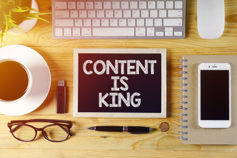 Content is King content marketing concept on work desk