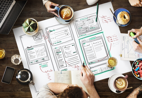 Website design and user interface demonstrated on paper