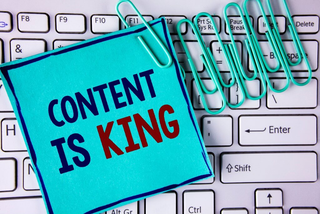 Content is king written on sticky note on keyboard