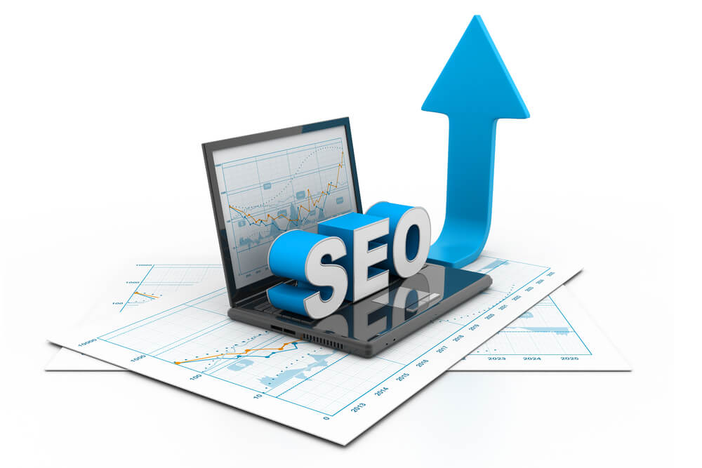 Computer showing SEO graphic with upwards pointing arrow