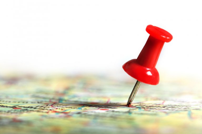 map with a thumbtack