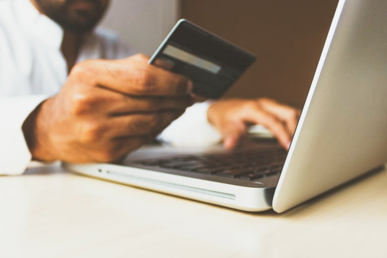 man entering credit card info on the web