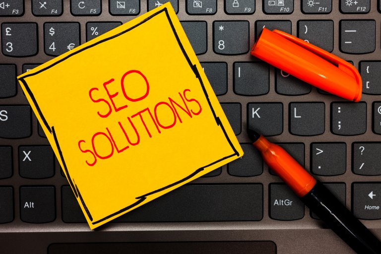 SEO Solutions on Post it note