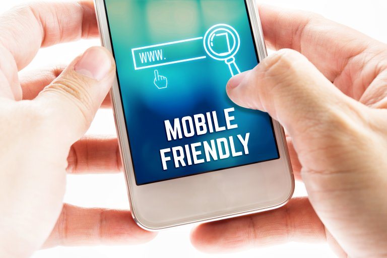 hands holding phone on mobile-friendly website