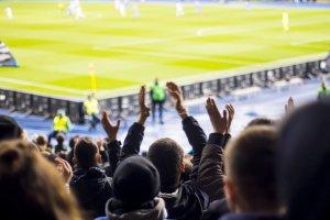 Soccer fans cheering at a stadium